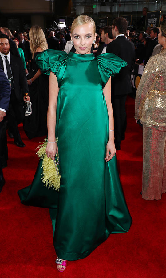 <a href=/tags/0/jodie-comer><strong>Jodie Comer</strong></a> was radiant in green with a feathered clutch. <p>Photo: &copy; Joe Scarnici/Getty Images for Moët and Chandon