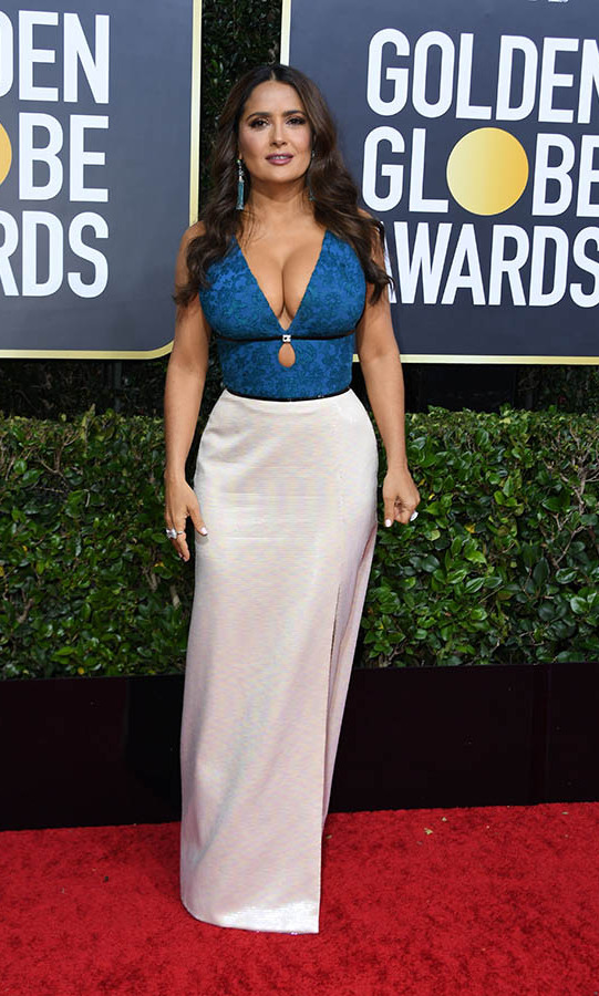 <a href=/tags/0/salma-hayek><strong>Salma Hayek</strong></a> smoldered on the red carpet in a blue and white combination by <a href=/tags/0/gucci><strong>Gucci</strong></a>.