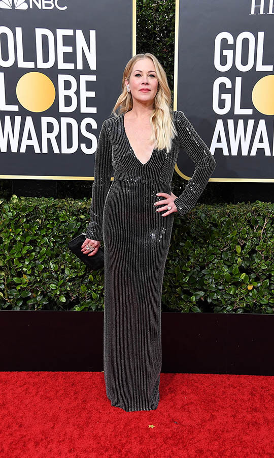 <a href=/tags/0/christina-applegate><strong>Christina Applegate</strong></a> dazzled in her inky gown with sparkly trim. <p>Photo: &copy; Steve Granitz/WireImage