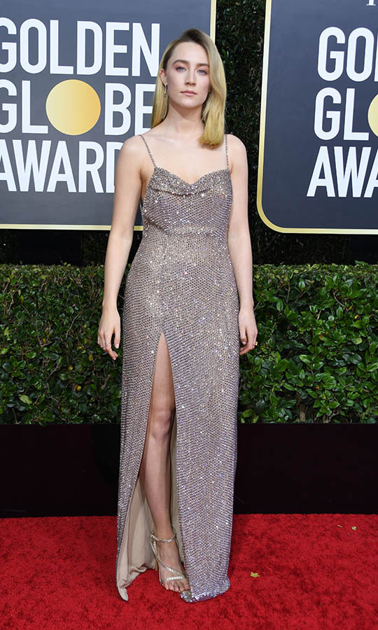 <a href=/tags/0/saoirse-ronan><strong>Saoirse Ronan</strong></a> made a statement in <a href=/tags/0/celine><strong>Celine</strong></a> with shimmering fabric and a leg-revealing slit. <p>Photo: &copy; VALERIE MACON/AFP via Getty Images