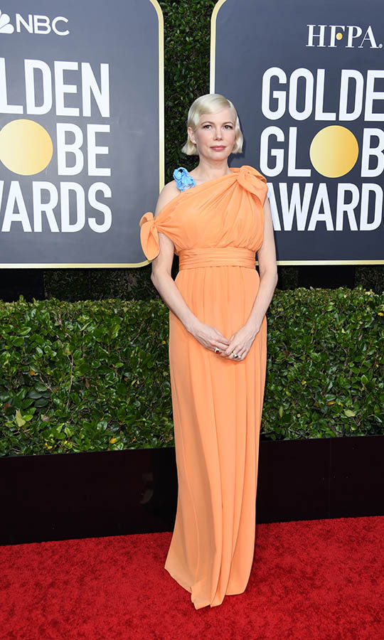 Expectant <a href=/tags/0/michelle-williams><strong>Michelle Williams</strong></a> channeled Old Hollywood in a  pale orange <a href=/tags/0/louis-vuitton><strong>Louis Vuitton</strong></a> gown with contrasting blue strap.<p>Photo: &copy; Jon Kopaloff/Getty Images
