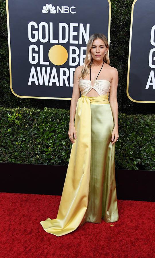 <a href=/tags/0/sienna-miller><strong>Sienna Miller</strong></a> brought her signature bohemian spirit to the carpet in this yellow and pistachio green <a href=/tags/0/gucci><strong>Gucci</strong></a> number with cutout. <p>Photo: &copy; Steve Granitz/WireImage