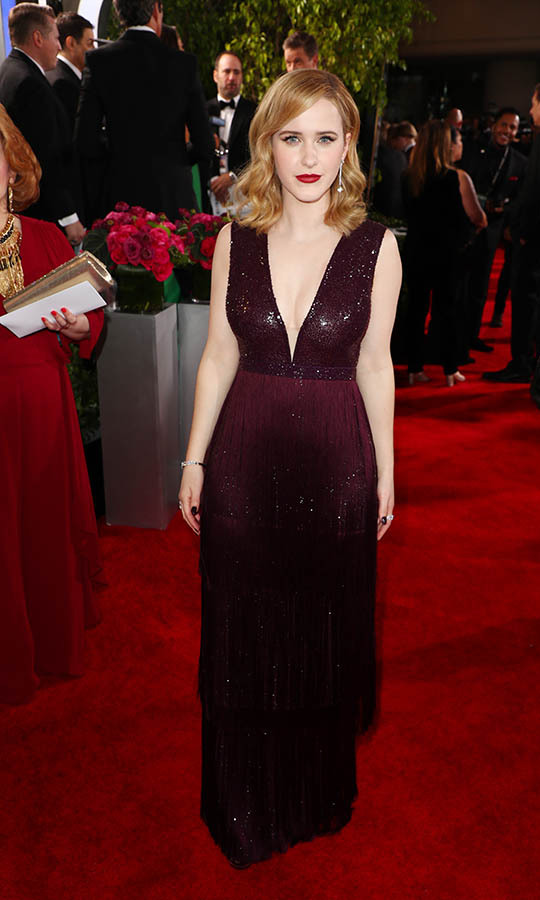 <a href=/tags/0/rachel-brosnahan><strong>Rachel Brosnahan</strong></a> looked elegant in an oxblood gown with deep V-neckline. <p>Photo: &copy; Joe Scarnici/Getty Images for Moët and Chandon