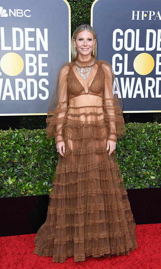 <a href=/tags/0/gwyneth-paltrow><strong>Gwyneth Paltrow</strong></a> showed some skin in a surprising brown <a href=/tags/0/fendi><strong>Fendi</strong></a> gown with frills and dripping jewels.<p>Photo: &copy: Jon Kopaloff/Getty Images