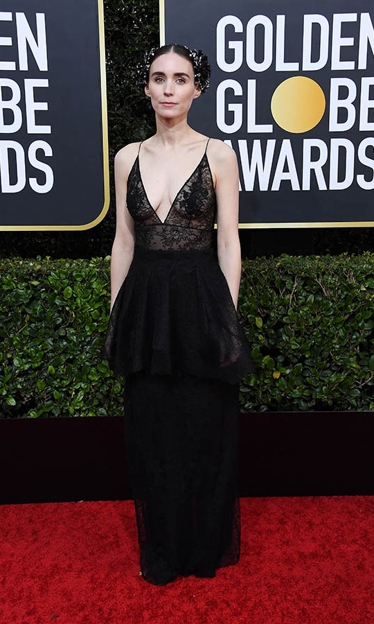 <a href=/tags/0/rooney-mara><strong>Rooney Mara</strong></a> wowed in her signature black with a tiered <a href=/tags/0/givenchy><strong>Givenchy Haute Couture</strong></a> gown and an ornate updo. <p>Photo: &copy; Steve Granitz/WireImage