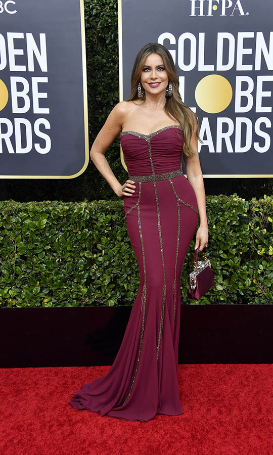 <a href=/tags/0/sofia-vergara><strong>Sofia Vergara</strong></a> looked red hot in raspberry red <strong>Dolce & Gabbana</strong>. <p>Photo: &copy; Frazer Harrison/Getty Images)