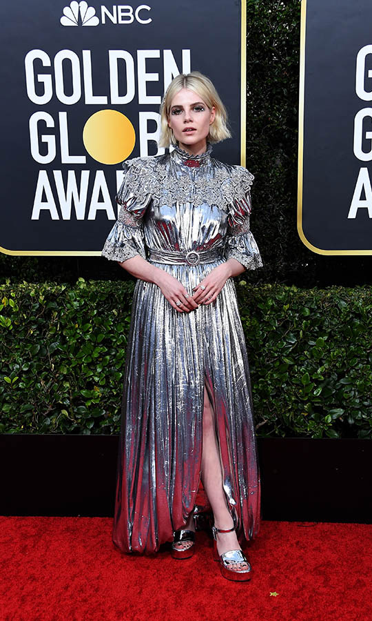 <a href=/tags/0/lucy-boynton><strong>Lucy Boynton</strong></a> absolutely shone in a metallic gown with coordinating sandals and sparkly makeup. <p>Photo: &copy; Steve Granitz/WireImage