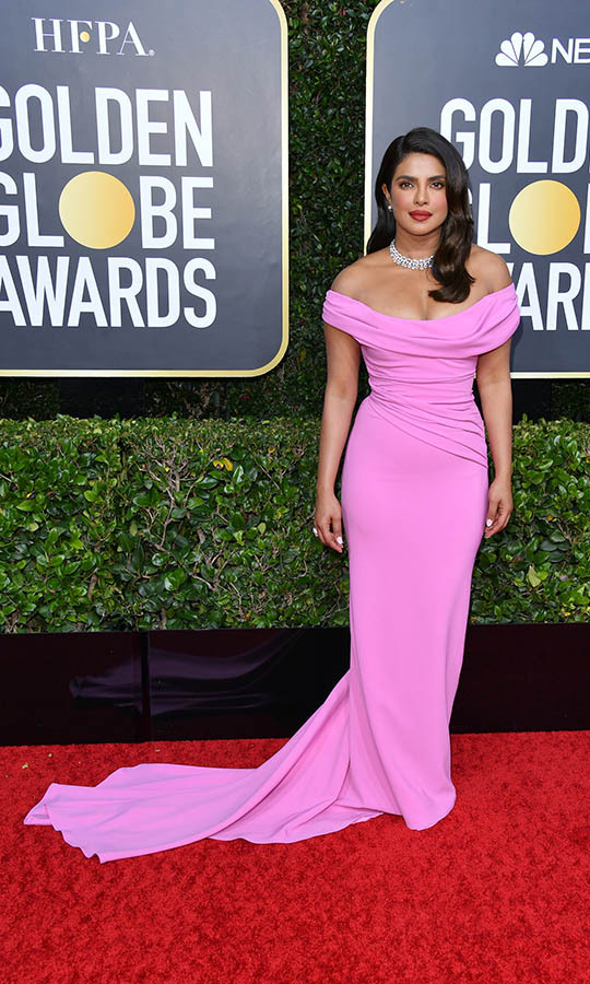 <a href=/tags/0/priyanka-chopra><strong>Priyanka Chopra</strong></a> turned heads in a bubblegum pink gown by <a href=/tags/0/vivienne-westwood><strong>Vivienne Westwood</strong></a>.<p>Photo: &copy: George Pimentel/WireImage