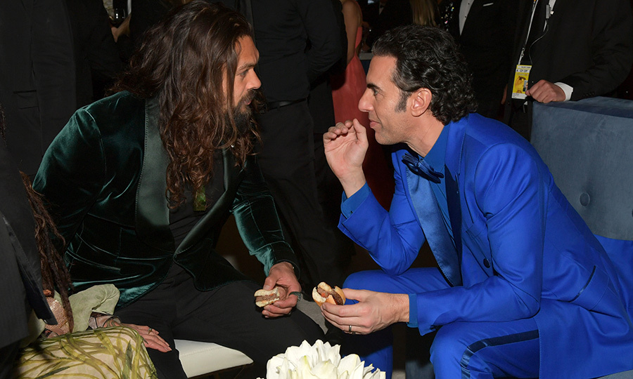 <a href=/tags/0/jason-momoa><strong>Jason Momoa</a></strong> and <strong><a href=/tags/0/sacha-baron-cohen>Sacha Baron Cohen</a></strong> were lost in conversation over sliders at the InStyle and Warner Bros. after-party at the Beverly Hilton.