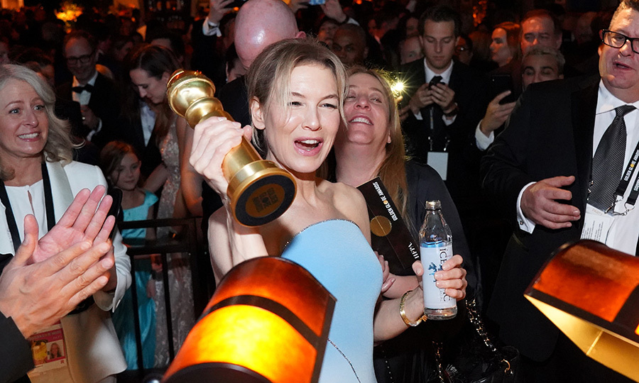 The dreams that you dream of really do come true! <strong><a href=/tags/0/renee-zellweger>Renee Zellweger</a></strong> walked into the HBO Golden Globes after-party, raising her award for <i>Judy</i> high.