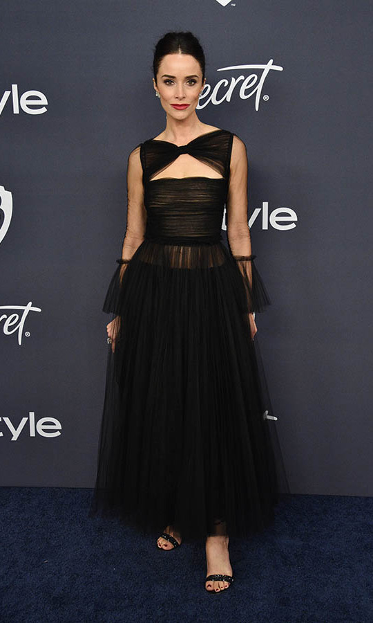 <a href=/tags/0/abigail-spencer><strong>Abigail Spencer</strong></a> looked timelessly chic in a black dress with bow neckline and sheer details at the 21st Annual Warner Bros. and InStyle Golden Globe after-party. <p> Photo: © Gregg DeGuire/WireImage