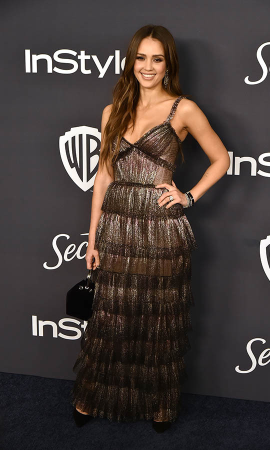 <a href=/tags/0/jessica-alba><strong>Jessica Alba</a></strong> dazzled in a tiered metallic dress at the Warner Brothers and InStyle 21st Annual Post Golden Globes after-party. <p>Photo: © David Crotty/Patrick McMullan via Getty Images