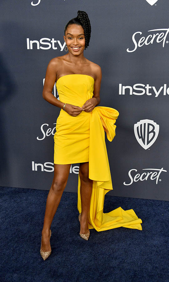 <a href=/tags/0/yara-shahidi><strong>Yara Shahidi</strong></a>'s marigold strapless dress by <a href=/tags/0/carolina-herrera><strong>Carolina Herrera</strong></a> was as bright as her smile at the 21st Annual Warner Bros. and InStyle Golden Globe after-party. <p>Photo: © Gregg DeGuire/WireImage