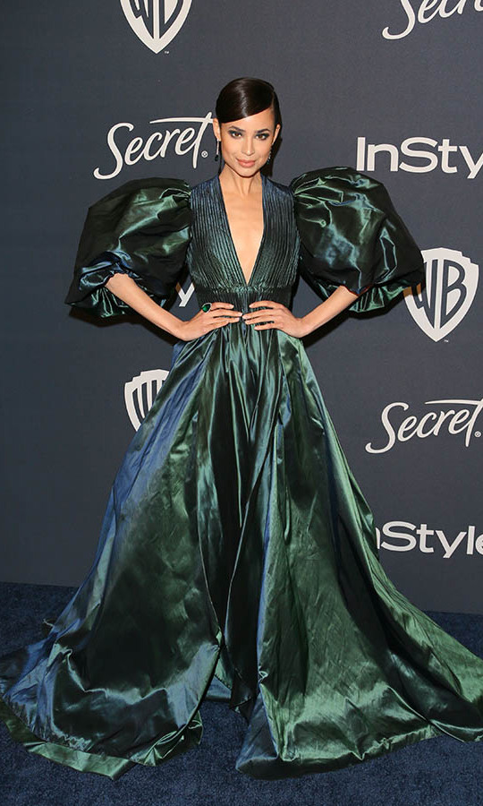 <a href=/tags/0/sofia-carson><strong>Sofia Carson</strong></a> oozed drama and elegance in her green-blue <a href=/tags/0/elie-saab><strong>Elie Saab</a></strong> gown at the 21st Annual InStyle and Warner Bros. Pictures Golden Globe after-party.<p>Photo: © JEAN-BAPTISTE LACROIX/AFP via Getty Images