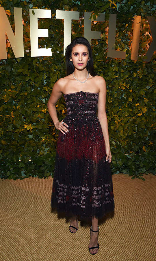 There was plenty of beautiful detail to take in on <a href=/tags/0/nina-dobrev><strong>Nina Dobrev</strong></a>'s oxblood tulle <a href=/tags/0/dior><strong>Dior</strong></a> gown at the Netflix 2020 Golden Globes after-party. <p>Photo: © Michael Kovac/Getty Images for Netflix