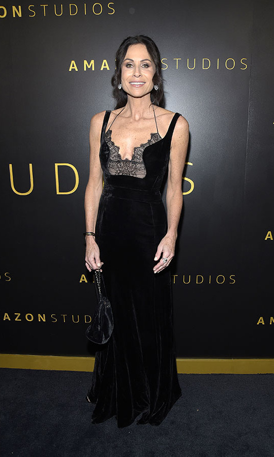 <a href=/tags/0/minnie-driver><strong>Minnie Driver</strong></a> looked elegant in a black gown with delicate straps and lace detail at the Amazon Studios Golden Globes after-party. <p> Photo: © Michael Tullberg/FilmMagic