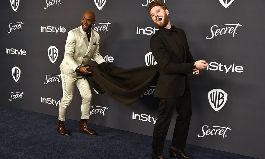 It's a mini <em>Queer Eye</em> moment! <strong><a href=/tags/0/karamo-brown>Karamo Brown</strong></a> helped showcase co-star <a href=/tags/0/bobby-berk><strong>Bobby Berk</strong></a>'s train on his statement suit at the Warner Brothers and InStyle 21st Annual Post Golden Globes after-party. <p> Photo: © David Crotty/Patrick McMullan via Getty Images