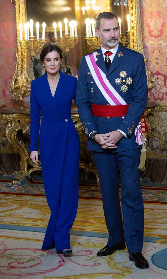 <a href=/tags/0/queen-letizia><strong>Queen Letizia</strong></a> and <a href=/tags/0/king-felipe><strong>King Felipe VI</a></strong> of Spain attended the New Year Military parade 2020 celebration at the Royal Palace on Jan. 6  in Madrid. She wowed in a royal blue maxi wrap dress with embellished button closure and elegant jewelry. <p>Photo: &copy; Pablo Cuadra/Getty Images