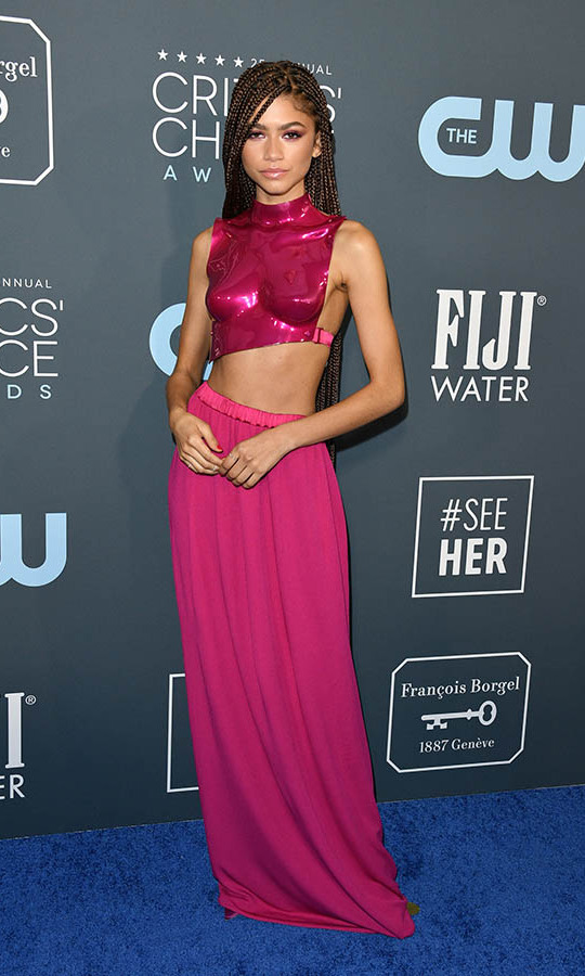 Fashionista <a href=/tags/0/zendaya><strong>Zendaya</strong></a> turned heads in a hot pink crop top and maxi skirt by <a href=/tags/0/tom-ford><strong>Tom Ford</a></strong>. <p> Photo: &copy; George Pimentel/WireImage
