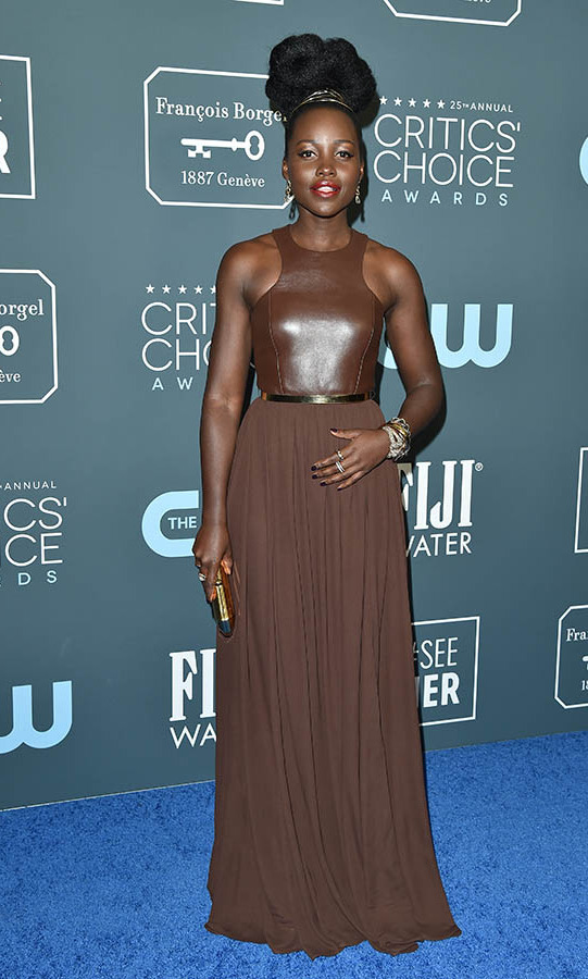 Wow! <a href=/tags/0/lupita-nyongo><strong>Lupita Nyong'o</strong></a> looked regal in a chocolate brown gown by <a href=/tags/0/michael-kors><strong>Michael Kors</strong></a>. <p> Photo: &copy; Axelle/Bauer-Griffin/FilmMagic