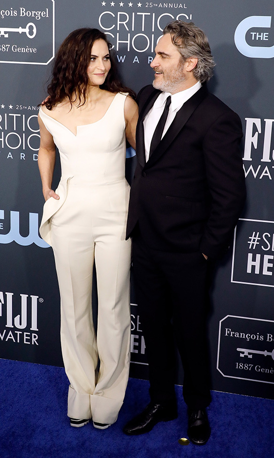 <a href=/tags/0/joaquin-phoenix><strong>Joaquin Phoenix</strong></a> and sister <strong>Rain Phoenix</strong> linked arms on the blue carpet. <p>Photo: &copy; Taylor Hill/Getty Images