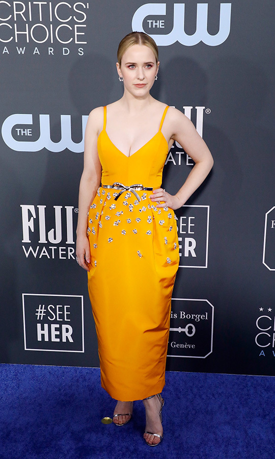 <a href=/tags/0/rachel-brosnahan><strong>Rachel Brosnahan</strong></a>'s ladylike <a href=/tags/0/carolina-herrera><strong>Carolina Herrera</strong></a> dress was trimmed with a bow at the waist. <p>Photo: &copy; Taylor Hill/Getty Images