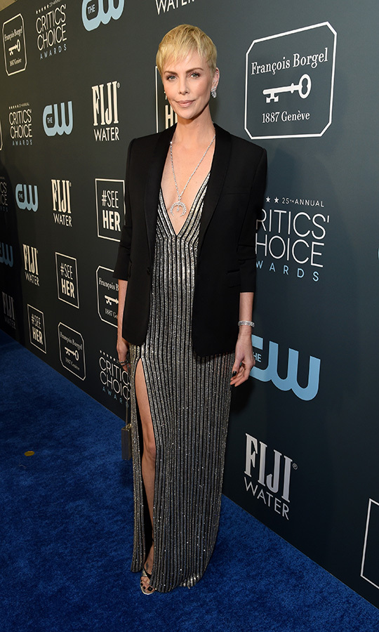 <a href=/tags/0/charlize-theron><strong>Charlize Theron</strong></a> juxtaposed her plunging striped gown with a structured black blazer to dazzling effect with her <strong><a href=/tags/0/celine>Celine</strong></a> look. <p> Photo: &copy; Michael Kovac/Getty Images for Champagne Collet
