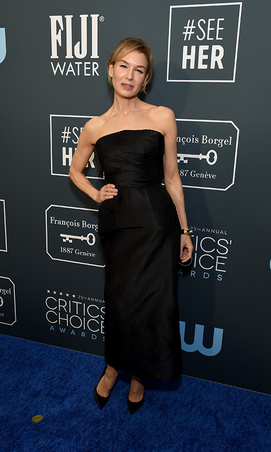 Lady in black! <a href=/tags/0/renee-zellweger><strong>Renée Zellweger</strong></a> beamed in an elegant strapless dress by <a href=/tags/0/dior><strong>Christian Dior</a></strong>. <p>Photo: &copy; Michael Kovac/Getty Images for Champagne Collet