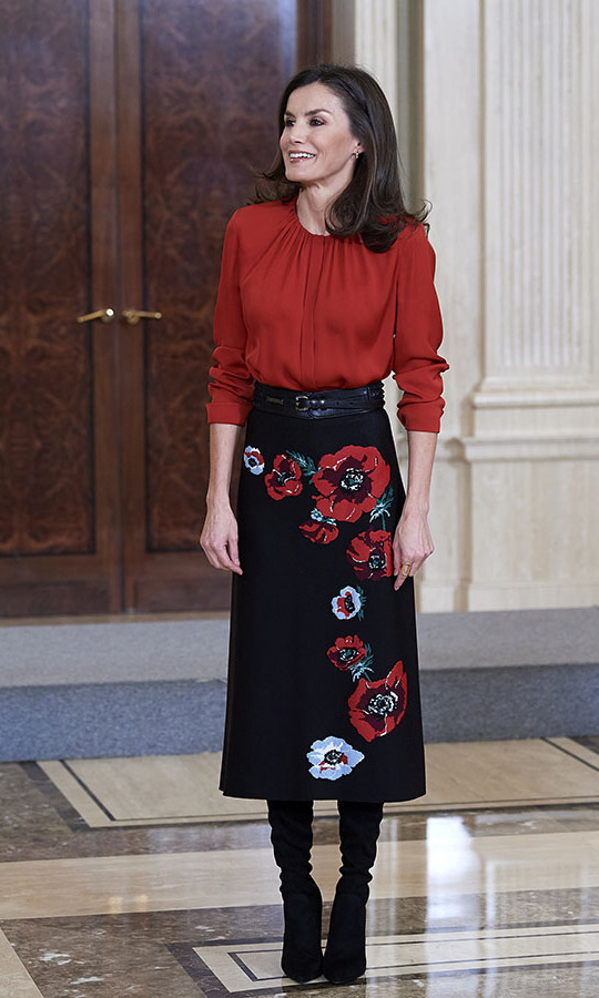 <a href=/tags/0/queen-letizia><strong>Queen Letizia</strong></a> recycled a beautiful <a href=/tags/0/carolina-herrera><strong>Carolina Herrera</a></strong> poppy skirt to attend several audiences at the Zarzuela Palace on Jan. 14 in Madrid, Spain. She paired it with an elegant red blouse and tall boots. <p> Photo: &copy; Carlos Alvarez/Getty Images