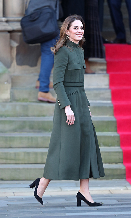 Kate was positively beaming as she and William arrived at Bradford City Hall. She looked gorgeous as ever, sporting a forest green <a href=/tags/0/alexander-mcqueen><strong>Alexander McQueen</a></strong> coat dress, which covered a <strong><a href=/tags/0/zara>Zara</a></strong> dress. The Duchess of Cambridge was in black heels and was carrying an <strong><A href=/tags/0/aspinal-of-london>Aspinal of London</a></strong> handbag.