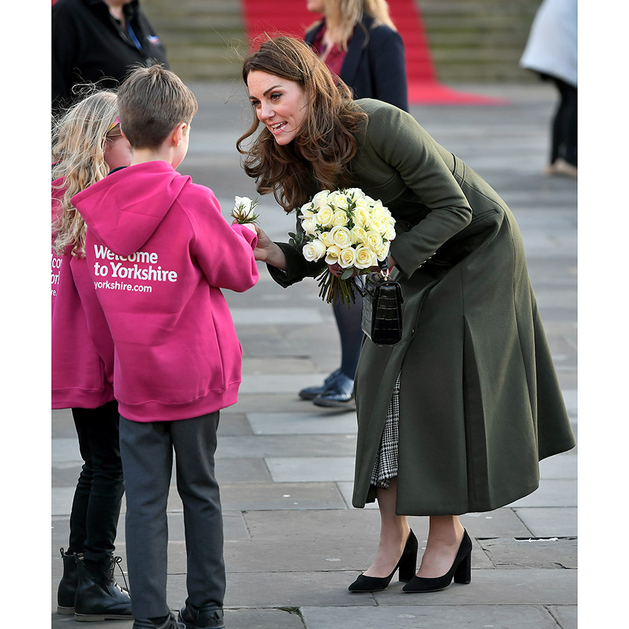 Kate also received a gorgeous bouquet of white roses, Yorkshire's flower, from two adorable youngsters.