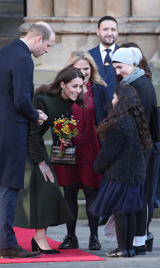 When the Cambridges left City Hall, Kate was given another bouquet! This one featured an assortment of flowers and she looked very pleased to receive it.