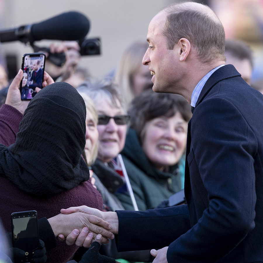 Outside City Hall, William stopped to shake hands with well-wishers and take a selfie!