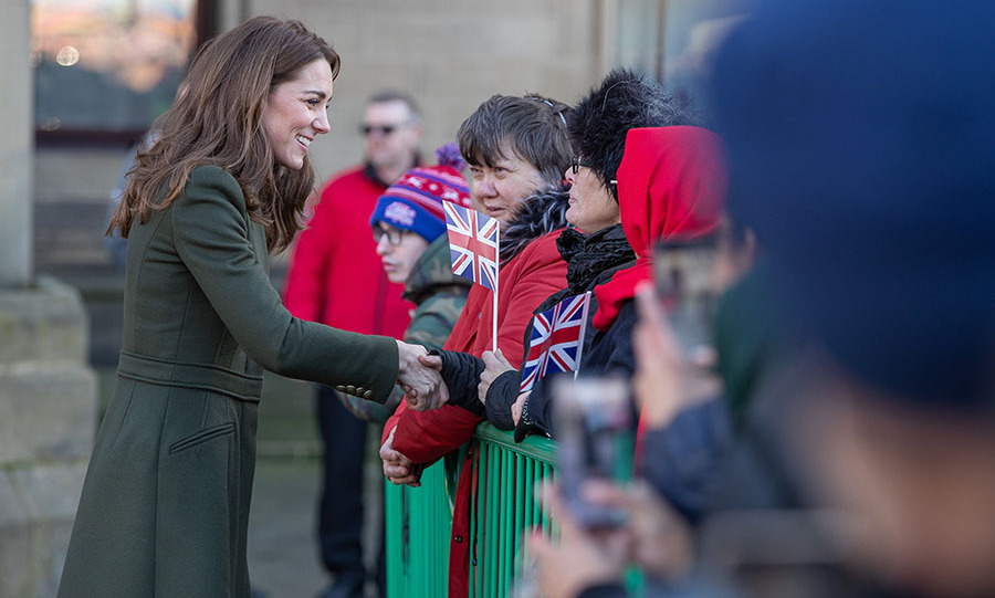 "The mom-of-three took time to engage with the crowds, including a boy named Josh, (pictured in the background) who received a hug from the duchess. <a href=""https://www.thesun.co.uk/news/10745416/kate-middleton-hugs-young-man-crowd/"">She reportedly told</a> the happy fan, ""<a href=""https://ca.hellomagazine.com/tags/0/prince-george"" target=""_blank""><strong>George</strong></a> would love your coat, he loves camouflage."" <p>Photo: © Charlotte Graham - WPA Pool/Getty Images"
