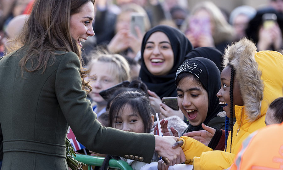 Kate visits City Hall in Bradford's Centenary Square where she interacted with young fans. One girl looks absolutely delighted to receive a handshake from the duchess! <p> Photo: © Mark Cuthbert/UK Press via Getty Images