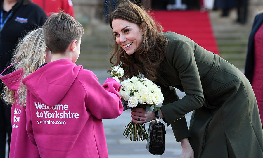 She accepted another flower from a young admirer, who wore a bright pink hoodie welcoming the Duke and Duchess of Cambridge to Yorkshire. <p>Photo: © Karwai Tang/WireImage