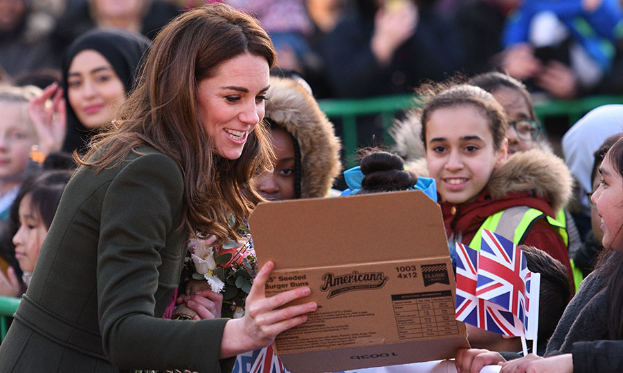 Kate admires a piece presented to her by a local primary school. <p>Photo: © OLI SCARFF/AFP via Getty Images
