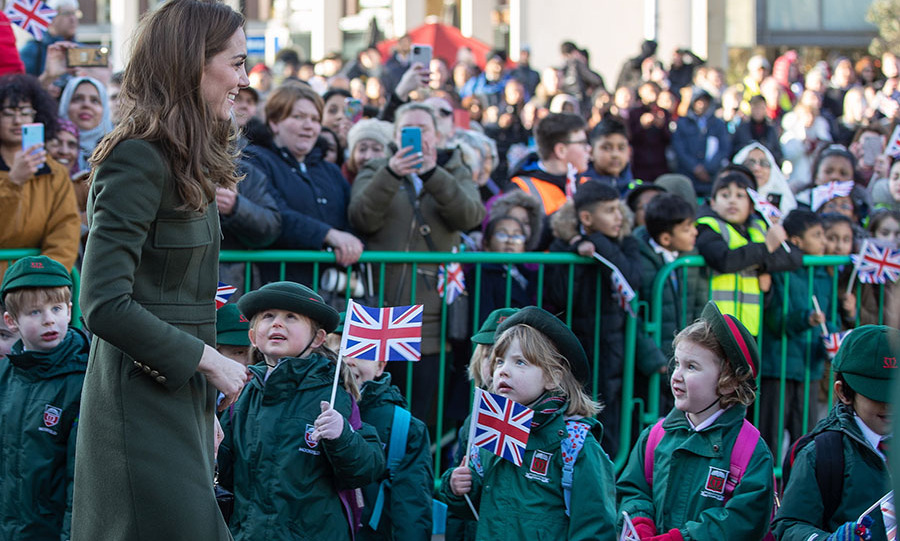 Young school children look on in awe as the duchess walks by. They waved their Union Jack flags in delight. <p>Photo: © Charlotte Graham - WPA Pool/Getty Images