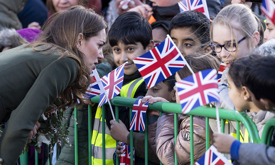 Kate chatted with flag-waving children during her walkabout of the city. <p>Photo: © Mark Cuthbert/UK Press via Getty Images