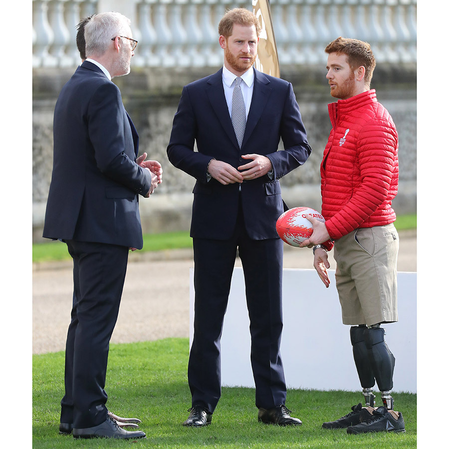 Before the draw, Harry watched a rugby practice of sorts on a makeshift pitch outside the Palace. He was joined by (right) <strong>James Simpson</strong>, a wheelchair rugby player who lost both of his legs in Afghanistan.