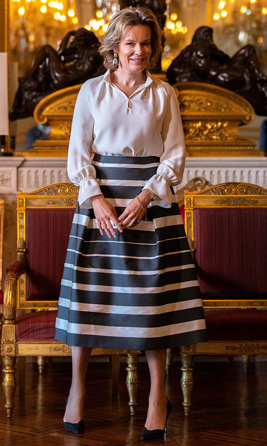 <a href=/tags/0/queen-mathilde><strong>Queen Mathilde</strong></a> looked elegant in a white blouse and striped skirt at the New Year's Reception for military, NATO and SHAPE officials at the Royal Palace in Brussels on Jan. 16. <p> Photo: &copy; Olivier Matthys/Getty Images