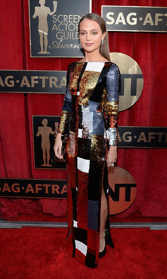 "<h2>Alicia Vikander, 2016</h2><p> Wearing a <a href=""https://ca.hellomagazine.com/tags/0/louis-vuitton""><strong>Louis Vuitton</strong></a> gown with gold, white and black sequined squares, <a href=""https://ca.hellomagazine.com/tags/0/alicia-vikander""><strong>Alicia Vikander</strong></a> stole the show at the 2016 SAG Awards. <p>Photo: © Kevork Djansezian/Getty Images"