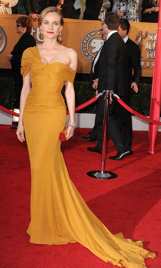 "<h2>Diane Kruger, 2010</h2><p> The actress's ochre-coloured <a href=""https://ca.hellomagazine.com/tags/0/jason-wu""><strong>Jason Wu</strong></a> gown isn't a shade we see a lot of on the red carpet. But, it left a lasting impression, especially with her choice to pair it with red lipstick! <p>Photo: © Steve Granitz/WireImage"