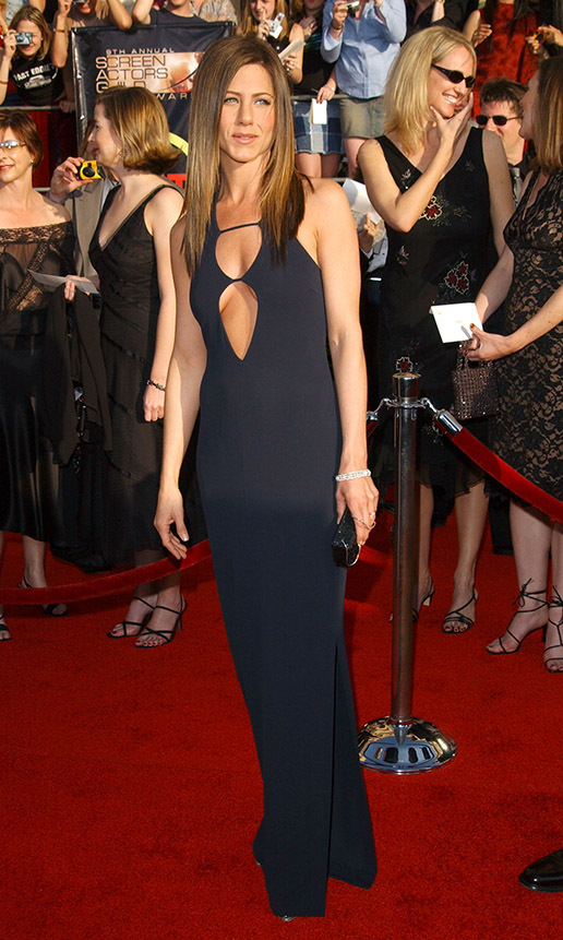 "<h2>Jennifer Aniston, 2003</h2><p><a href=""https://ca.hellomagazine.com/tags/0/jennifer-aniston""><strong>Jennifer Aniston</strong></a> mastered minimalism at the 9th Annual Screen Actors Guild Awards in a slinky black dress with cut-out detail. <p>Photo: © Jon Kopaloff/Getty Images"
