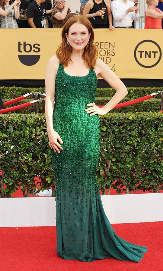 "<h2>Julianne Moore, 2015</h2><p> <a href=""https://ca.hellomagazine.com/tags/0/julianne-moore""><strong>Julianne Moore</strong></a>'s emerald green <a href=""https://ca.hellomagazine.com/tags/0/givenchy""><strong>Givenchy</strong></a> dress was the perfect complement to her pale complexion and red hair. And the beaded fringe added some playfulness! <p>Photo: © Amy Graves/WireImage"