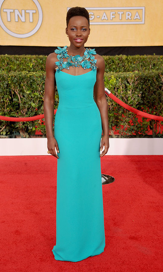 "<h2>Lupita Nyong'o, 2014</h2><p><a href=""https://ca.hellomagazine.com/tags/0/lupita-nyongo""><strong>Lupita Nyong'o</strong></a> uplifted the red carpet with her turquoise <a href=""https://ca.hellomagazine.com/tags/0/gucci""><strong>Gucci</strong></a> gown with floral embellished neckline. <p>Photo: © Gregg DeGuire/WireImage"