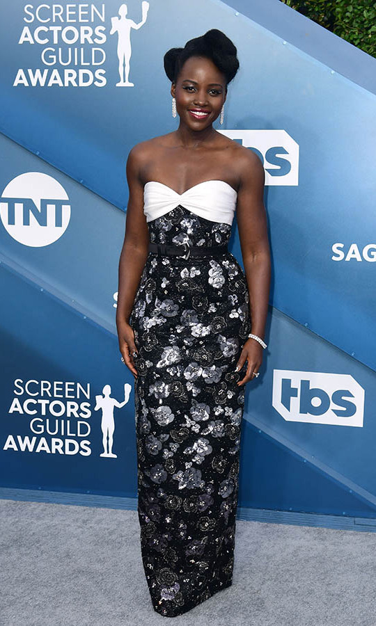 <a href=/tags/0/lupita-nyongo><strong>Lupita Nyong'o</strong></a> looked gorgeous in a monochromatic dress with incredible detail. <p>Photo: &copy; FREDERIC J. BROWN/AFP via Getty Images