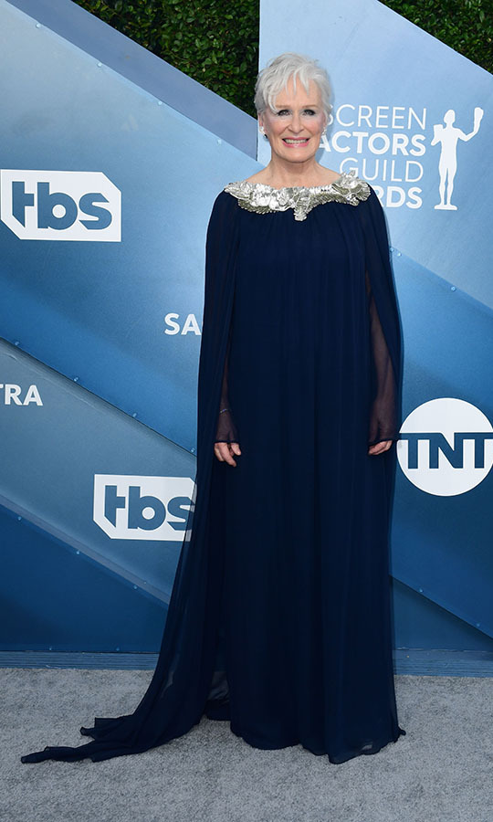<strong>Glenn Close</strong> looked regal in a flowing navy gown with beaded neckline. <p>Photo: &copy; FREDERIC J. BROWN/AFP via Getty Images