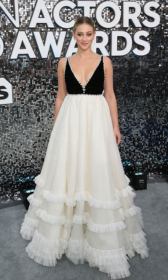 <strong>Lili Reinhart</strong> looked so pretty in a black and white gown with delicate frills. <p>Photo: &copy; Jean-Baptiste Lacroix / AFP