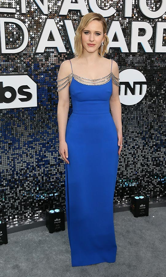 <a href=/tags/0/rachel-brosnahan><strong>Rachel Brosnahan</a></strong> didn't need a necklace thanks to the draped beading on her bold blue dress. <p>Photo: &copy; JEAN-BAPTISTE LACROIX/AFP via Getty Images